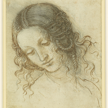 A drawing of the head of a woman turned three quarters to the left, looking down. The hair is fastened in elaborate braids, and arranged in coils over the ears. This is a study for the head of Leda in the lost painting of Leda and the Swan. Melzi's n