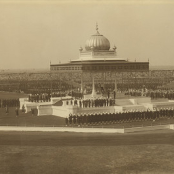 Three gelatin silver photographs framed alongside each other to form a panorama of three individual key moments taken during the Delhi Durbar of 1911. Each photograph features King George V and Queen Mary.