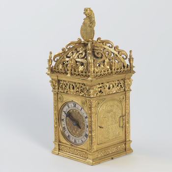 A gilt-bronze wall hung clock, the striking movement with a single steel hand, in a square tabernacle case, the top pierced with foliage and scrolls containing the bell, surmounted by a leopard holding a shield with the Royal coat of arms and Garter; the