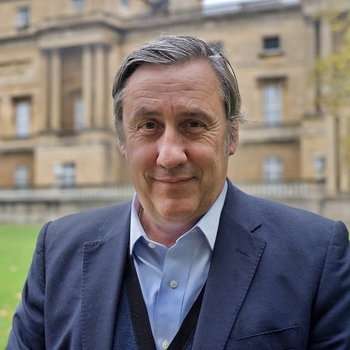 Andrew Graham Dixon stands in the garden of Buckingham Palace