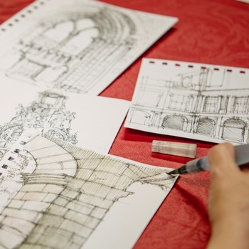 image of drawings and pens