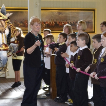 Pupils visit the Gold State Coach at the Royal Mews