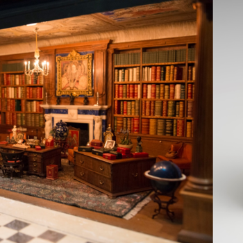 (left) View of the library within Queen Mary's Dolls' House, (right) Close up of the Dolls' House book 'A Note of Explanation' by Vita Sackville West.