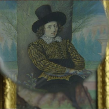 A magnifying glass hovering over a miniature portrait