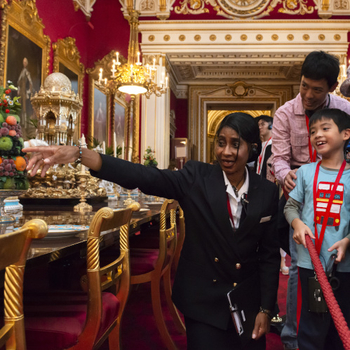 Warden talks to family inside Buckingham Palace State Rooms