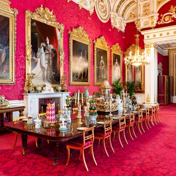 The State Dining Room table at Buckingham Palace laid for a banquet