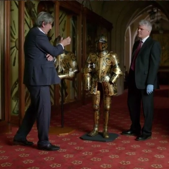 Simon and Andrew Graham-Dixon stand next to the Prince of Wales' armour