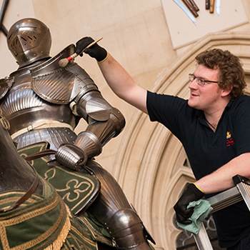 Armour being cleaned at Windsor Castle