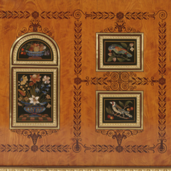 close up of wooden cabinet decorated with inlaid flowers and birds