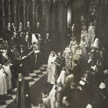 Photograph of King George VI, with the bride, Princess Elizabeth (later HM The Queen) on his arm, at the beginning of the walk up the aisle of Westminster Abbey
