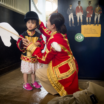 Child in livery at Royal Mews