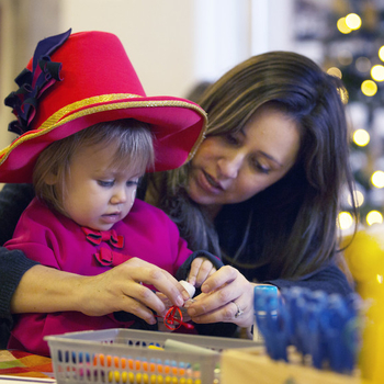 Mother and child creating Christmas decorations
