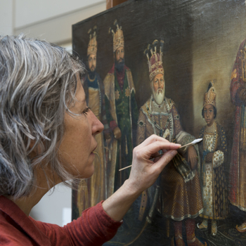 'An Indian Rajah and his family' being worked on by a conservator