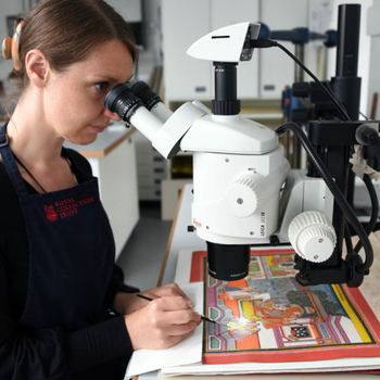 Conservator working on South Asian painting
