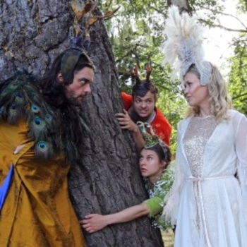 picture of actors in A Midsummer Night's Dream standing by a tree