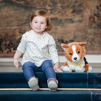 Child with toy dog