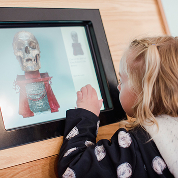 Child with interactive screen at Palace of Holyroodhouse.