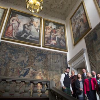 A group admiring the tapestries in the Palace of Holyroodhouse on a Private Morning Tour