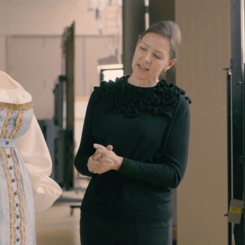 Conservators work on the dress and the portrait of Princess Charlotte in which she is wearing it