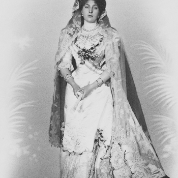 Photograph of a full length portrait of Queen Victoria Eugenie in her wedding dress