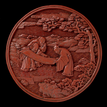 Pair of circular two-tiered carved red lacquer boxes and covers, straight-sided and flat-based, with flanged rim for the tier above. On the top of RCIN 3306.1, a scholar with an attendant holding a spray and a basket filled with lingzhi, approached by an