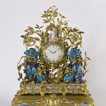 The misnamed 'kylins' of the time-honoured title of this clock are the pair of squatting lions of turquoise- and purple-glazed porcelain from the first half of the eighteenth century which flank the clock case, their open jaws displaying their