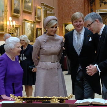 HM The Queen and King William view items in the Picture Gallery of Buckingham Palace