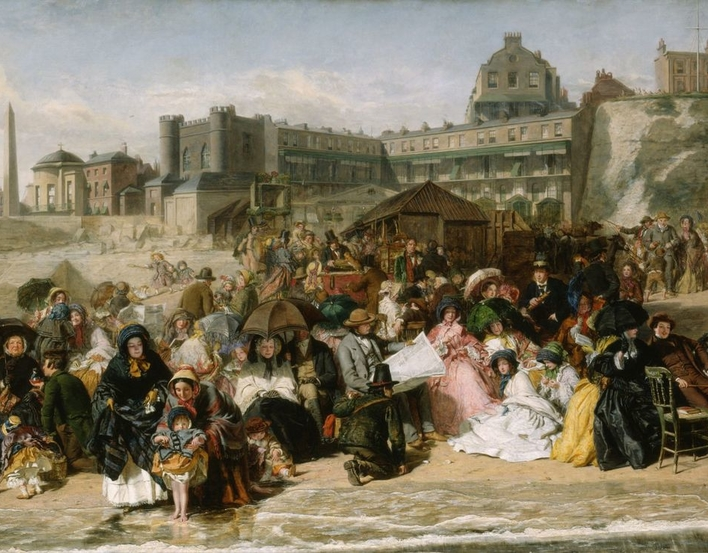 Ramsgate, a seaside resort on the Kentish coast, became accessible for day trips from London in the 1840s as a result of the development of the railways. In Frith's picture children building sandcastles and fashionably dressed young ladies appear alongs