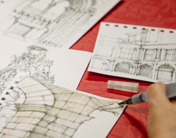 photograph of drawings and pens