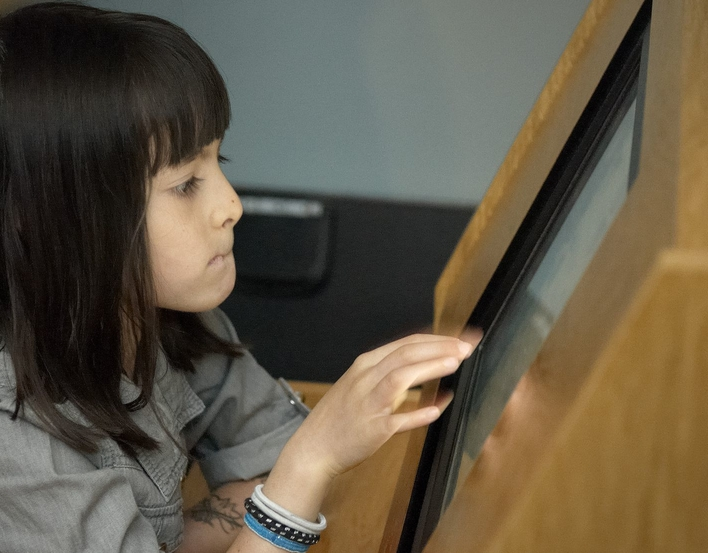 A child using the e-gallery at The Queen's Gallery, Palace of Holyroodhouse