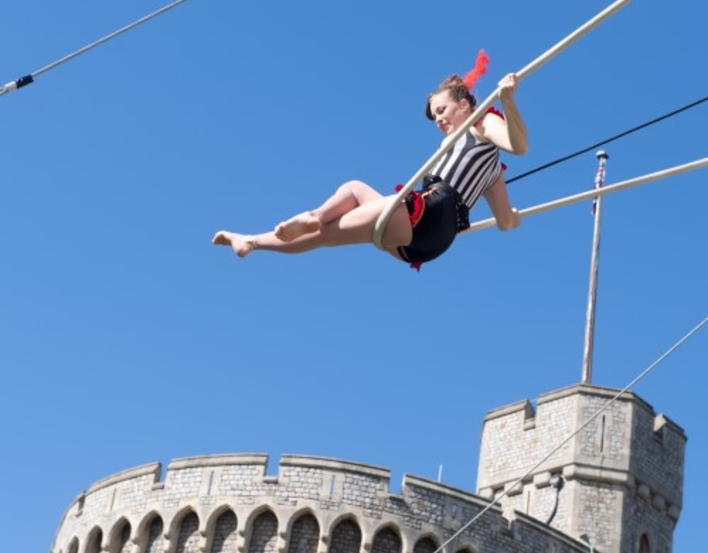 acrobat with the Round Tower at Windsor in the background