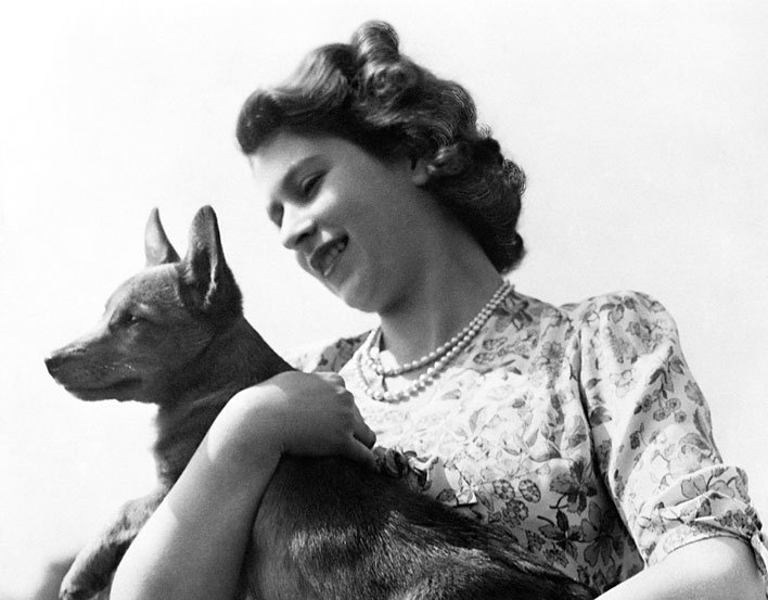Her Majesty Queen Elizabeth II when Princess Elizabeth, with her corgi