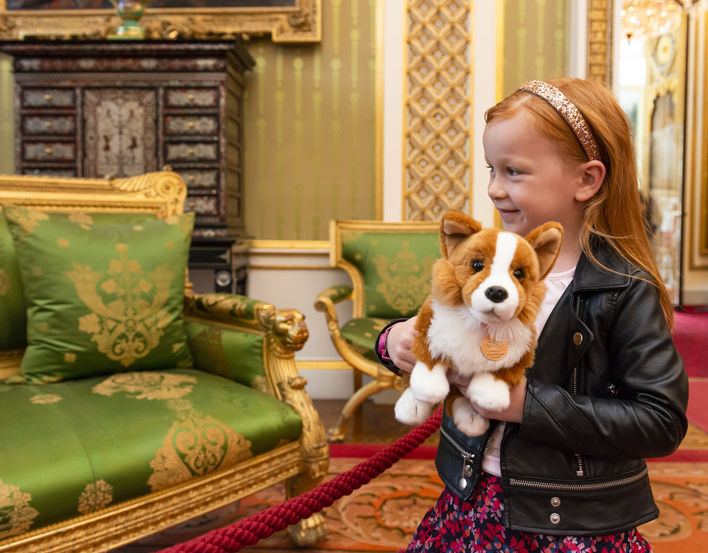 Child with stuffed dog in Royal Palace