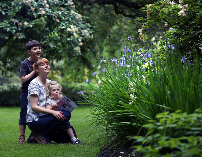 Family in the gardens at the Palace of Holyroodhouse