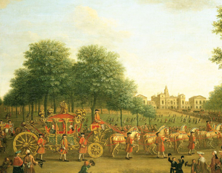 Carriage approaching a house, surrounded by people