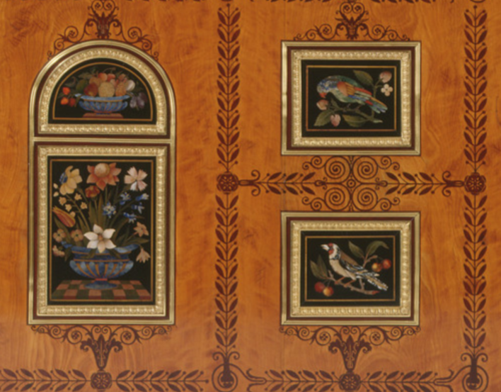 close up of inlaid decoration of flowers and birds on wooden cabinet