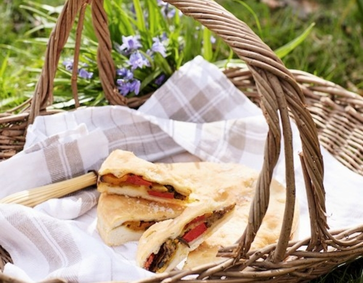 Image of grilled vegetable focaccia in a picnic basket