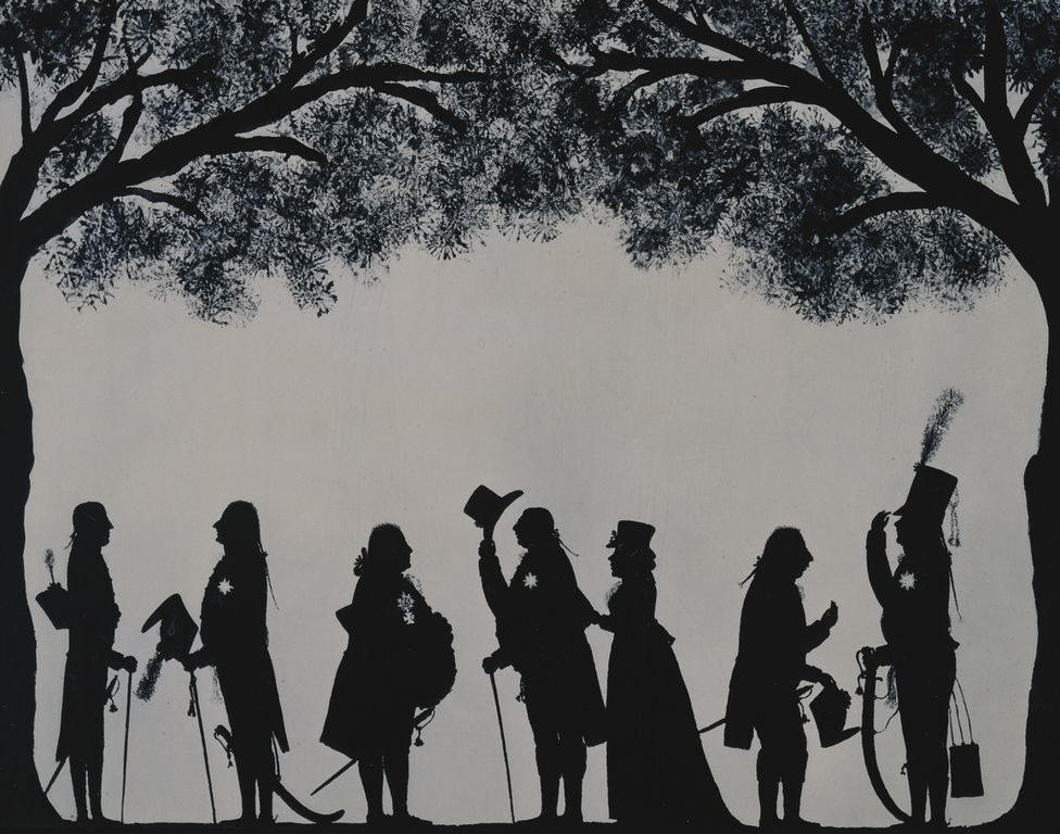 Silhouette of group of people at Weymouth