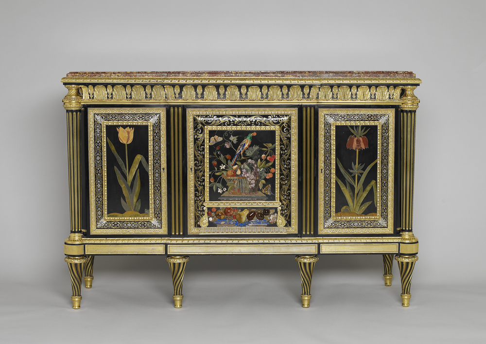 Rectangular cabinet veneered with ebony and set with three pietra dura panels of flowers and birds, the central panel incorporating high relief pietra dura fruit; bordered with premiere partie boulle marquetry on tortoiseshell. Fitted with three doors con