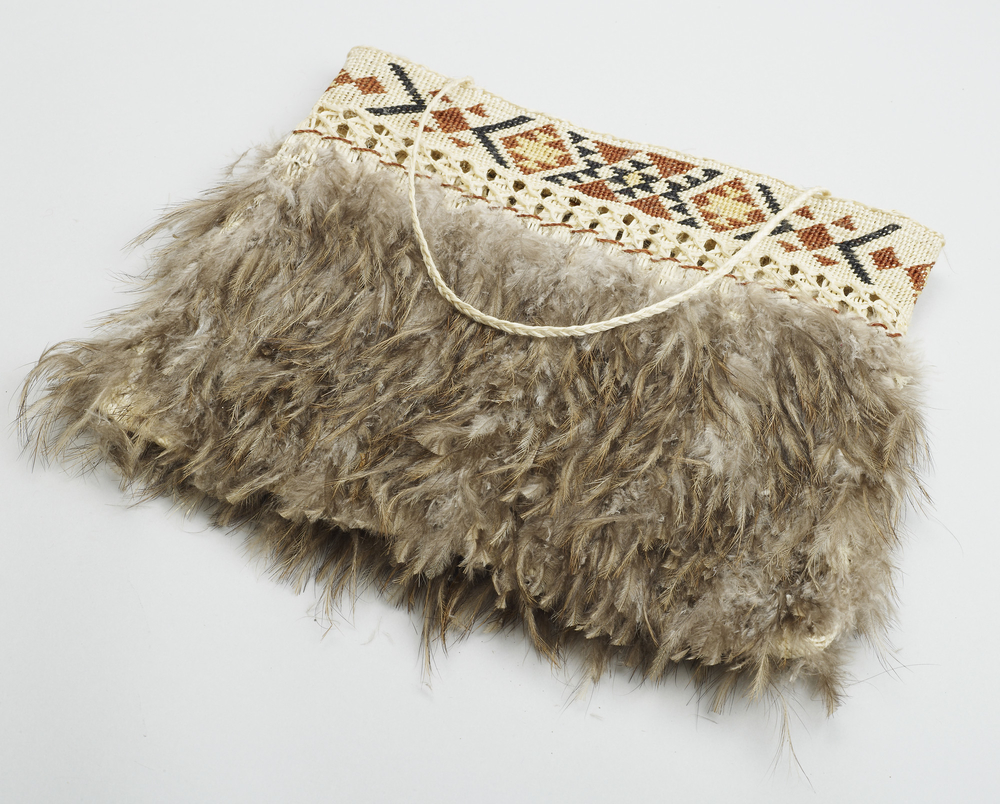 A Maori bag made of flax and kiwi feathers. The kiwi bird holds a special significance for the Maori - it is symbolic of elder brothers and sisters, representing their protective spirits.   During a visit to New Zealand in October 1981, the Te Atiawa p