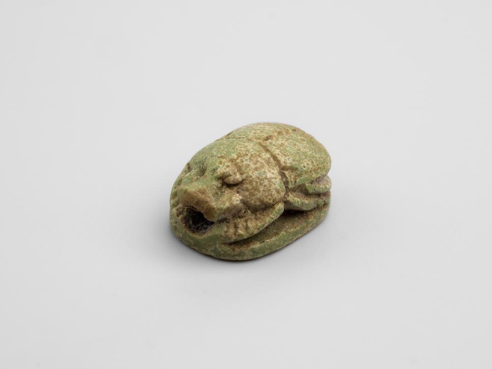 Miniature, very small, green stone scarab