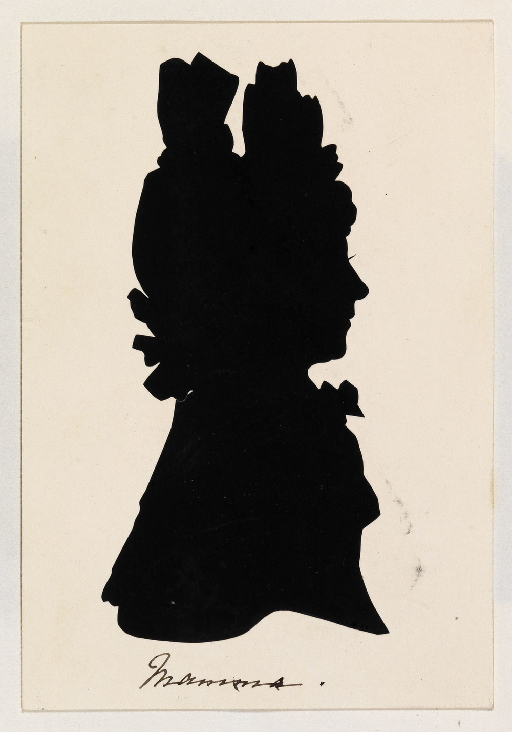 A silhouette showing a portrait of Princess Victoria's mother, the Duchess of Kent. She is shown bust-length and facing right in profile. She is wearing an elaborate headdress and a high frilled collar. Inscribed below: Mamma.