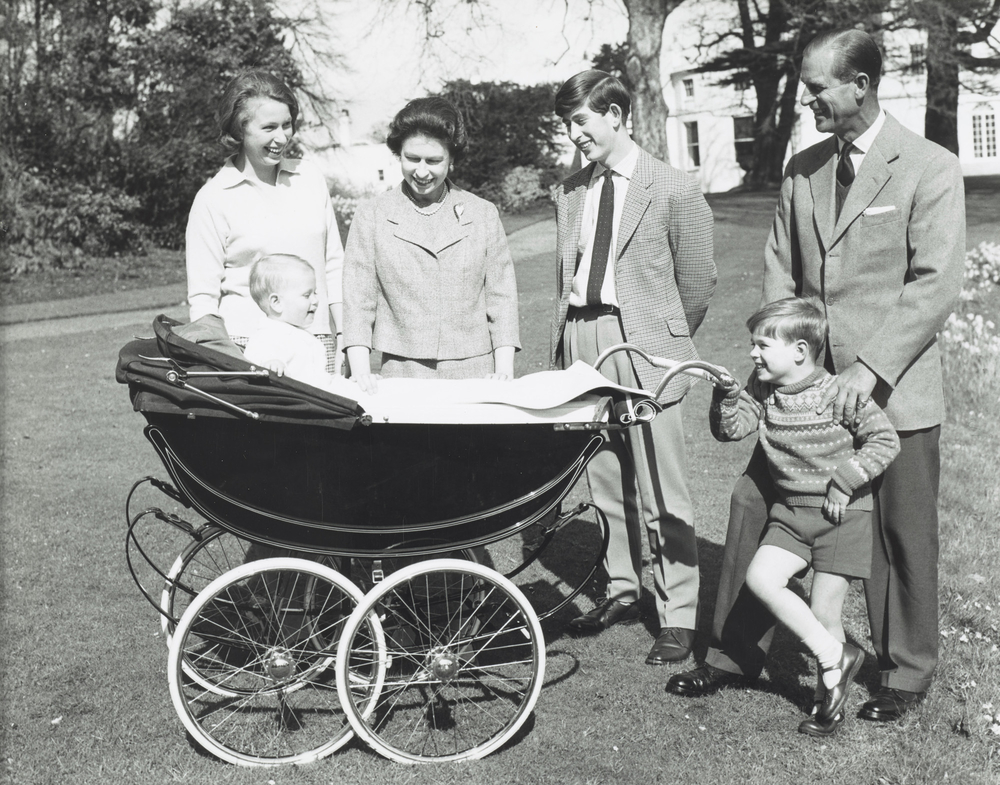 The Royal Family gathered together with Prince Edward in his pram on The Queen's 39th birthday in the garden at Frogmore; from left to right: Princess Anne, The Queen, Prince Charles, The Duke of Edinburgh, Prince Andrew. This photo reissued in1981