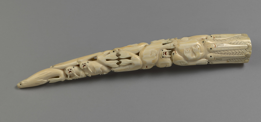 "<span class=""webgridrowlabel"">A carved and pierced walrus tusk with&nbsp;animals and fish along the full length, including halibut, cod, seals and polar bears. O</span>n an ebonised stand with an engraved silver presentation plaque."