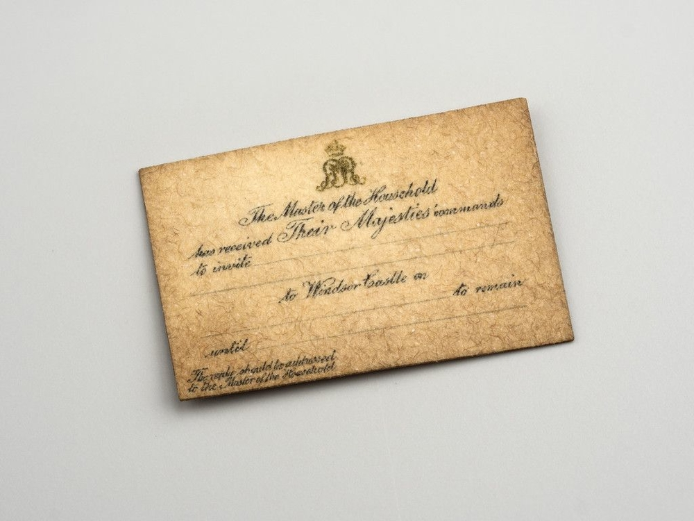 Miniature invitation cards printed in black with gold crowned GMR
