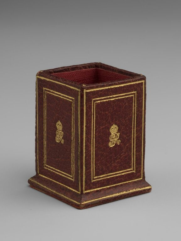 Miniature red leather square section waste paper bin, each side with gold tooled crowned GvR and plain line borders.