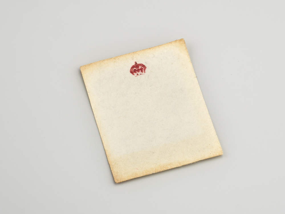 Miniature writing paper with crowned M monogram in red.