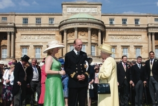 Her Majesty The Queen receives guest during one of her annual garden parties.